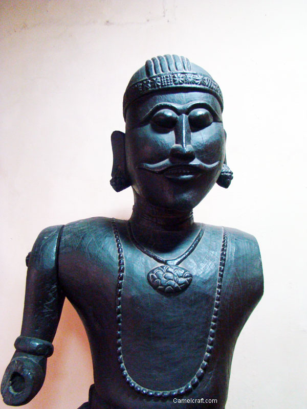 Statue of a man, black sculpture, an example of old Indian Art and craft
